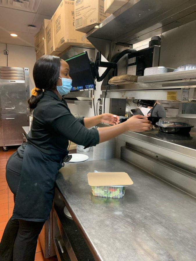 Pictured above is senior Mori Tillman taking care of a to-go order at Olive Garden, her workplace. Photo taken by Mariam Hanna.